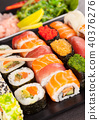 sushi pieces with chopsticks 40376276