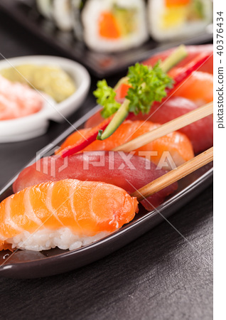 sushi pieces with chopsticks 40376434