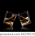Glasses of whiskey on black background 40376519