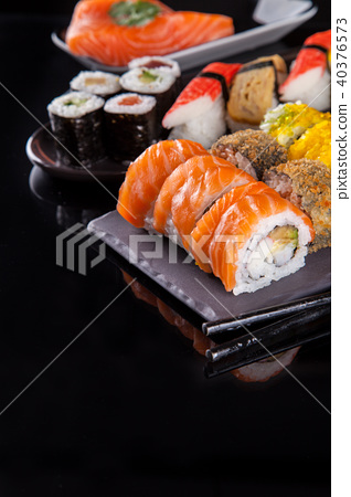 Delicious sushi pieces served on black stone 40376573