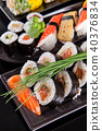 Delicious sushi pieces served on black stone 40376834