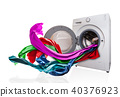 Colored cloth flying from washing machine 40376923