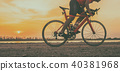 A cyclist riding a road bike on road in the moring 40381968