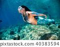 Mermaid swimming underwater in the deep blue sea 40383594