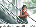 Business woman checking phone 40388654