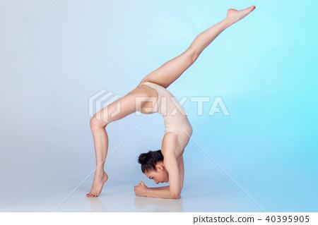 slim gymnast in beige swimsuit 40395905