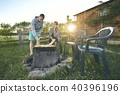 Couple barbecuing on the garden 40396196