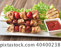 Grilled chicken skewers on the white plate 40400238