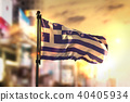 Greece Flag Against City Blurred Background 40405934