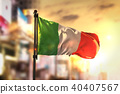 Italy Flag Against City Blurred Background 40407567