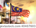 Malaysia Flag Against City Blurred Background 40407603