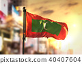 Maldives Flag Against City Blurred Background 40407604
