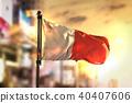 Malta Flag Against City Blurred Background 40407606