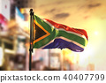 South Africa Flag Against City Blurred Background 40407799