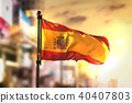 Spain Flag Against City Blurred Background 40407803