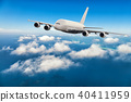 Commercial jet plane flying above clouds 40411959
