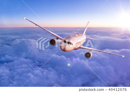 Commercial airplane flying above clouds 40412076