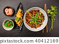 Asian noodles with spicy soy sauce and chicken 40412169