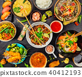 Asian food served on black stone, top view 40412193