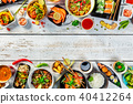 Asian food served on wooden table, top view, space for text 40412264