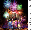 Champagne glasses with fireworks on background 40412634