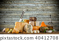 Various types of cheese placed on wooden table 40412708