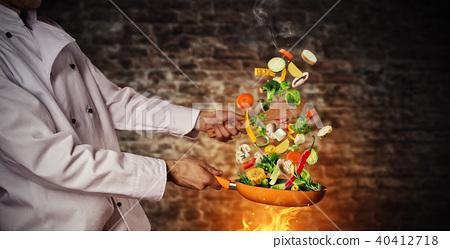 Closeup of chef preparing vegetable on pan 40412718