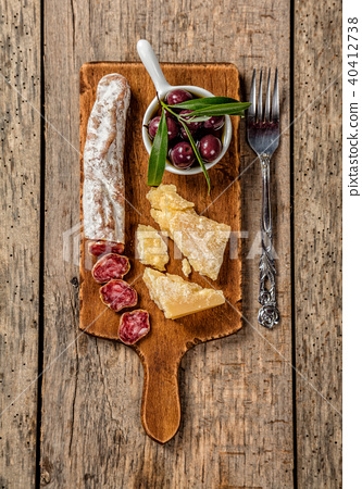 Various kind of cheese and delicacy on wood 40412738