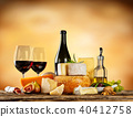 Various types of cheese with red wine 40412758