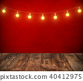 Hanging light bulbs on rope with red background 40412975