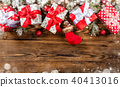 Christmas gift boxes placed on wooden planks 40413016