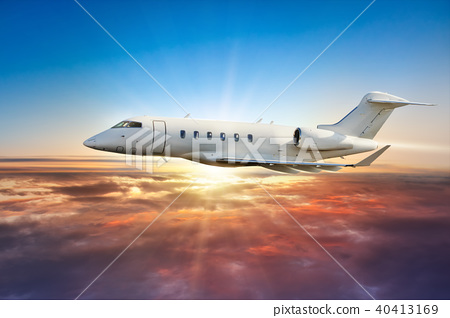 Private jetplane flying above clouds in sunset 40413169
