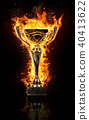 Burning gold trophy cup on black background 40413622