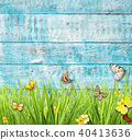 Idyllic spring meadow with butterflies with old wooden planks on background. 40413636