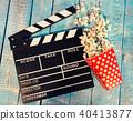 Film camera chalkboard with popcorn 40413877