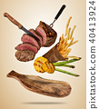 Flying beef steaks with grilled vegetable and french fries served on wooden cutting board. 40413924
