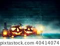 Spooky halloween pumpkins on wooden planks 40414074