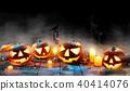 Spooky halloween pumpkins on wooden planks 40414076