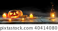 Spooky halloween pumpkins on wooden planks 40414080