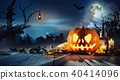 Spooky halloween pumpkin on wooden planks 40414096