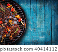 Top view of fresh meat and vegetable on grill placed on wooden planks 40414112