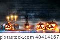 Spooky halloween pumpkins on wooden planks 40414167