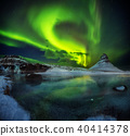 Kirkjufell mountain with beautiful aurora borealis and frozen water falls 40414378