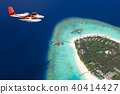 Sea plane flying above Maldives islands 40414427