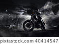 High power motorcycle chopper with man rider at night 40414547