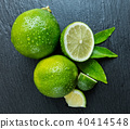 Fresh limes place on black stone 40414548