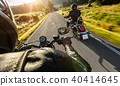 Two motorbikers riding on empty road 40414645