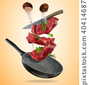 Flying raw steaks with cooking ingredients from pan 40414687