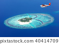 Sea plane flying above Maldives islands 40414709
