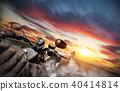 Motorbike riders driving towards cityscape panorama 40414814